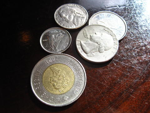 Picture of US coins given as change at a Canadian restaurant